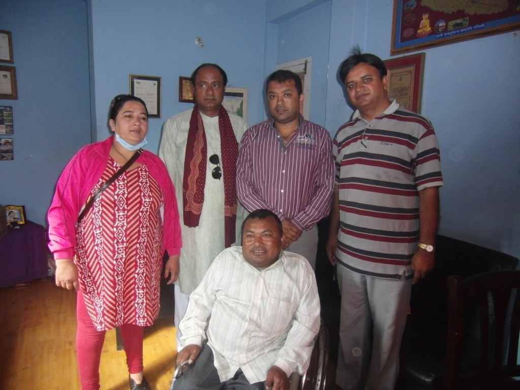 Gagan Thapa with the people with disabilities